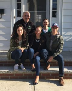 Photo of Lauren with her family outside their home